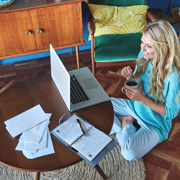 Modern lifestyle Blonde woman smiling enjoying working from home having flexible work hours